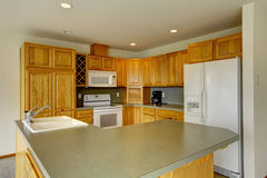 American wooden corner kitchen with gray counter tops. Stock Photos