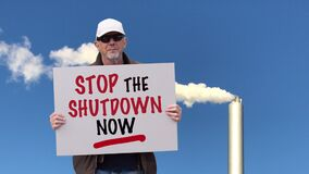 American worker with cap and sunglasses in Corona Covid-19 lockdown protest.