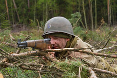 American World War II trooper during combat. American World War II infantry soldier prepering for shooting Royalty Free Stock Photos