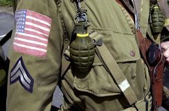 American world war two GI soldier. Details of American World War two GI soldier wearing army uniform with hand grenades and corporal stripes Stock Images