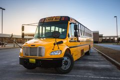 American Yellow Black School Bus on School Grounds Transportatio. N Vehicle stock images