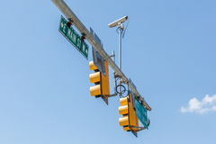 American yellow traffic lights  on blue sky background. Stock Image