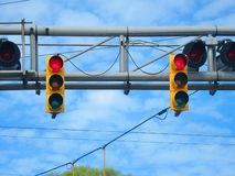 American yellow traffic train rail lights on blue sky Stock Photography