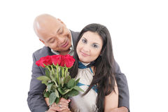 American young couple with bunch of roses Royalty Free Stock Photography