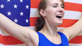 American Young Woman Celebrates holding the Flag of USA in Slow Motion. 4k , high quality stock video footage