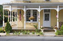 Americana classic yellow porch Stock Photography