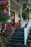 Americana. A country store located in the heart of Maine. From the adirondack chairs, flowers and american flags this is a typical old fashioned scene stock photography