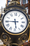Americana old clock face. American old fashioned clock face Stock Images