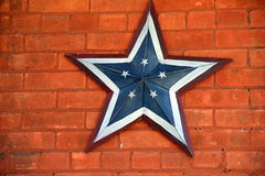 Americana Star On Red Brick Background Royalty Free Stock Photos