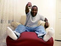 Americano africano que presta atenção à tevê 6 Fotos de Stock Royalty Free