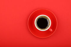 Americano coffee in full cup with saucer on red Royalty Free Stock Image