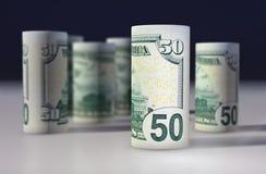 Americano 50 dollari di dollaro acciambellato sul nero Fotografia Stock