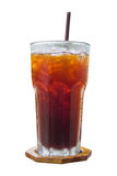 Americano in glass on wood plate isolated on white background. Stock Photo