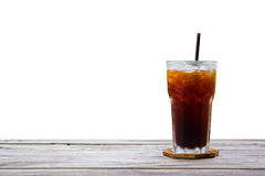 Americano in glass on wood plate and table isolated on white background. Stock Image