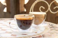 Americano och cappuccino royaltyfria foton