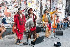 Americans. Unidentified Amerindians perform in traditional costumes during street show at Istiklal Street on July 06, 2010 in Istanbul. Beyoglu district is the Stock Photos