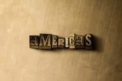 AMERICAS - close-up vintage sujo da palavra typeset no contexto do metal Imagem de Stock