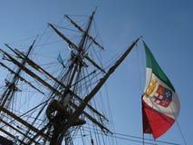 Amerigo Vespucci masts. Close up of  Amerigo Vespucci masts and italian flag against blue sky Royalty Free Stock Images