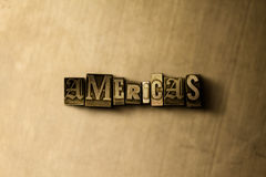 AMERIKA - Nahaufnahme des grungy Weinlese gesetzten Wortes auf Metallhintergrund Stockbild