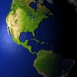 Amerika op model van Aarde met in reliëf gemaakt land Stock Afbeeldingen