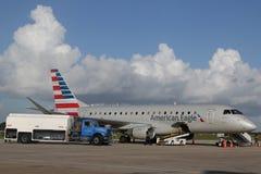 Amerikaans Eagle-vliegtuig op tarmac bij La Romana International Airport stock afbeelding