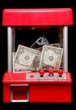 Amerikaans geld in een het grijpen machine Royalty-vrije Stock Afbeelding