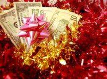 Amerikaanse dollar in Kerstmis Stock Foto's