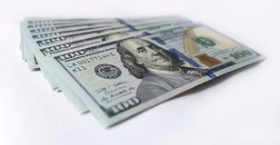 Amerikaanse dollar op witte achtergrond stock afbeeldingen