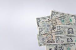 Amerikaanse dollars in een hoek op witte achtergrond Royalty-vrije Stock Foto's
