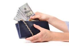 Amerikaanse dollars Handen die geld van portefeuille nemen stock afbeeldingen
