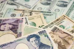 Amerikaanse dollars, Japanse Yen Stock Foto's