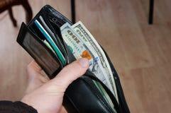 Amerikaanse dollars in mijn portefeuille royalty-vrije stock afbeelding