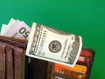 Amerikaanse Dollars in portefeuille Stock Foto's