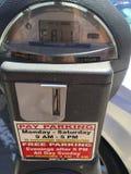 Amerikaanse reis en autoparkeermeters stock foto