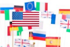 Amerikaanse vlag tegen vlaggen van EG-lidstaten royalty-vrije stock foto's