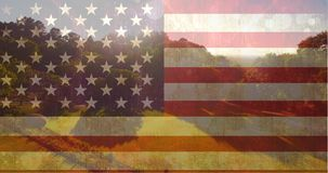 Amerikaanse vlag tegen vrij groen landschap stock video