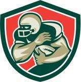 Amerikaanse Voetbal die terug het Afweren Schild in werking stellen royalty-vrije illustratie