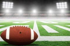 Amerikaanse Voetbal op Gebied met Stadionlichten en Exemplaarruimte royalty-vrije stock fotografie