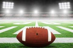 Amerikaanse Voetbal op Gebied met Stadionlichten en Exemplaarruimte royalty-vrije stock afbeelding