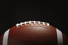 Amerikaanse Voetbalbal op donkere achtergrond royalty-vrije stock afbeeldingen