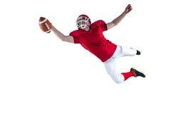 Amerikaanse voetbalster die een touchdown noteren Stock Foto's