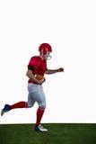 Amerikaanse voetbalster die met voetbal lopen Royalty-vrije Stock Foto