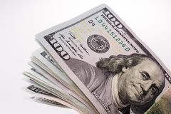 Amerikan 100 dollarsedlar som förläggas på vit bakgrund Royaltyfri Bild