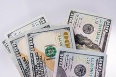 Amerikaner 100 Dollarbanknoten gesetzt auf weißen Hintergrund Lizenzfreie Stockfotos