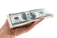 Amerikaner hundert Dollar rollen in der Hand zusammen Lizenzfreies Stockbild