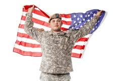 AMERIKANISCHE Armee-Förster mit amerikanischer Flagge Stockfotos