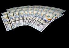 Amerikanische Dollar auf schwarzem Hintergrund Lizenzfreies Stockbild
