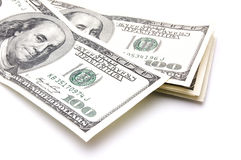 Amerikanische Dollar des Bargeldes auf einem weißen Hintergrund stockbilder