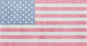 Amerikanische Flagge auf einer Gewebebeschaffenheit Stockfotografie