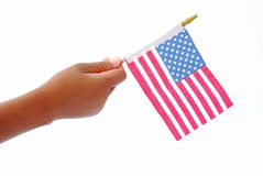 Amerikanische Flagge in der schwarzen Hand Stockfoto